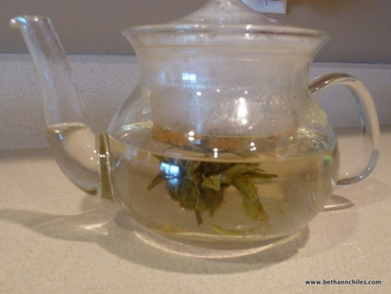 View of tea blooming in the teapot