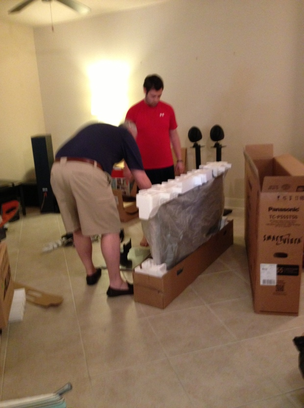 Chris and Micah packing up the tv.