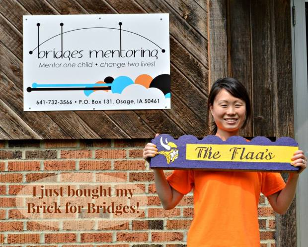 My friend Jeni Flaa shows off her personalized brick from the Bridges Brick Fundraiser