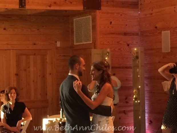 The new Mr. and Mrs. Scott enjoying their first dance.